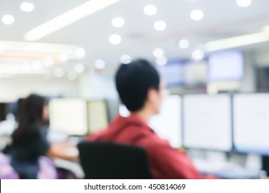 blurred network employee working on computer at operation room for monitor system concept.