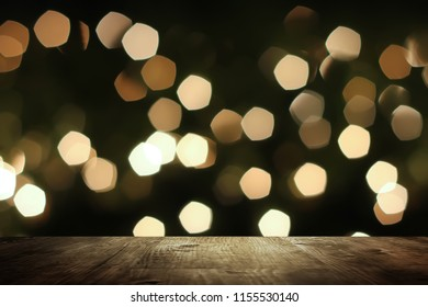 Blurred Night Background and Bokeh with wooden table for Product and Text