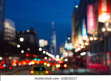 Blurred night lights of Manhattan street scene near Chelsea Piers in New York City, NYC