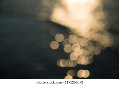 blurred ocean background with reflections and bokeh