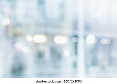 BLURRED OFFICE BACKGROUND WITH CITY LIGHTS REFLECTIONS IN THE WINDOW, MODERN BUSINESS BACKDROP