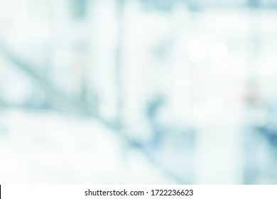 BLURRED OFFICE BACKGROUND, LIGHT BUSINESS HALL, WHITE AND BLUE DEFOCUSED INTERIOR, MEDICAL BACKDROP
