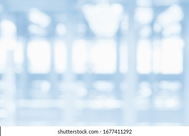 BLURRED OFFICE BACKGROUND WITH LIGHTS REFLECTIONS IN THE WINDOW, MODERN BUSINESS SPACE