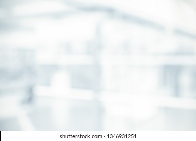 BLURRED OFFICE BACKGROUND, MODERN COMMERCIAL HALL IN SUN LIGHT