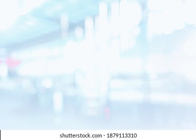 BLURRED OFFICE BACKGROUND, MODERN LIGHT BUSINESS HALL WITH WINDOW LIGHT REFLECTIONS AND WHITE LIGHTNINGS