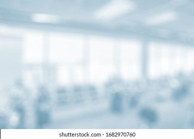 BLURRED OFFICE BACKGROUND, SPACIOUS BUSINESS HALL WITH WHITE WINDOWS