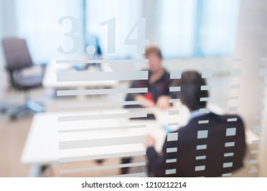 blurred office background two coworkers having a meeting. Focus on window