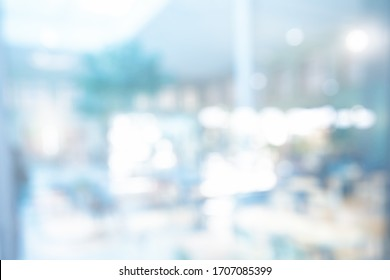 BLURRED OFFICE BACKGROUND WITH WINDOW LIGHT REFLECTIONS, MODERN LIGHT ROOM