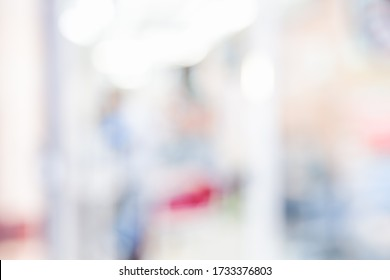 BLURRED OFFICE BACKGROUND WITH WINDOW LIGHT REFLECTIONS, MODERN DEFOCUSED INTERIOR OF WHITE BOKEH AND RED AND BLUE COLORS