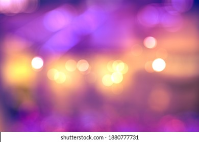 BLURRED OFFICE INTERIOR WITH GLOWING LIGHTS AND BOKEH, DARK ILLUMINATED ROOM