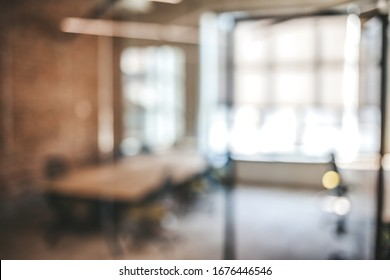 Blurred office interior space background. Blurred interior of modern office workplace a workspace design without partition decorate with black, white and wooden furniture