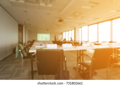 Blurred office with sun rays