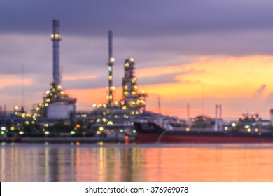 Blurred Oil refinery at twilight. blur backgrounds concept