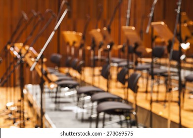 Blurred Orchestra stage with chairs and microphone as Background