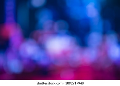 Blurred, out of focus photo, night neons bokeh, vivid blue and purple colors, cyberpunk atmosphere. Amazing wallpaper backdrop. Night city street.