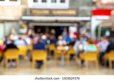 Blurred  outdoor cafe background. Out of focus restaurant picture.