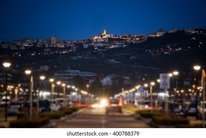 Blurred park and in backgroud Chieti (Italy)