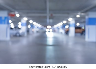 Blurred parking image/ Parking in interior shot of multi-story car park, underground parking with cars.