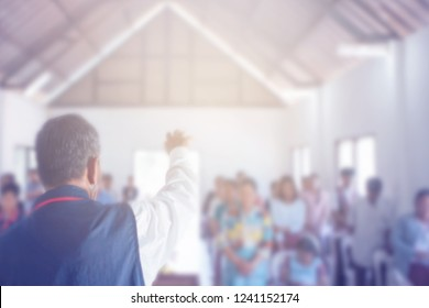 blurred of a pastor prays for people in a small christian local church , Christian background with copy space