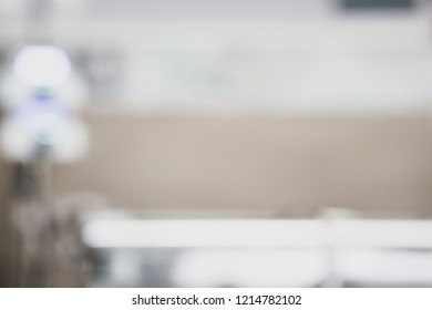 Blurred Patient in hospital therapy recovery on bed room blood donation and saline bag drip fluid machine for serious diagnosed coma emergency sick, thalassemia treatment, cancer chemotherapy, surgery