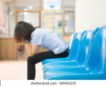 Blurred Patients In Doctors Waiting Room