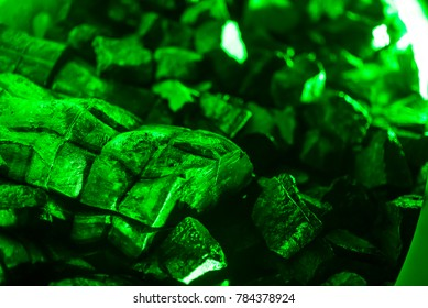blurred pattern of green kriptonite stone macro mineral for background, weapons against superman.