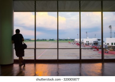 Blurred people airport terminal travel departure concept.