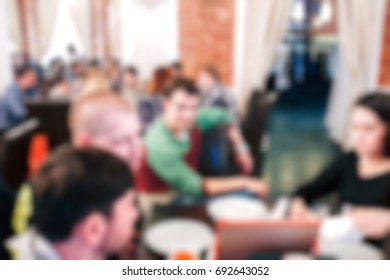 Blurred people in the banquet room with gala dinner.