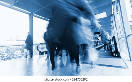 Blurred people in business center hall
