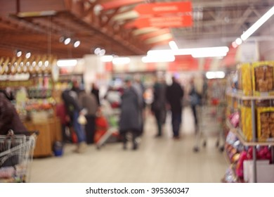 Blurred people in line in the supermarket
