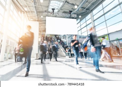 blurred people in a modern hall