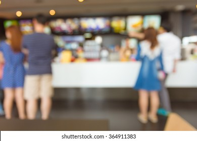 Blurred people order fast food for background.