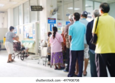 Blurred people and patient waiting for the doctor, hospital activities background