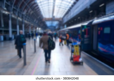 Blurred people at a railway station traveling by train