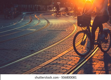 Blurred of people riding bicycle during the sunset in the city of Bordeaux in vintage style and grain texture with copy space