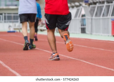 blurred - people running - Walking on a running track - Use For fitness or competition.
