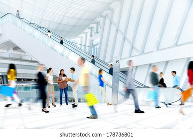 Blurred People Rushing in Shopping Mall