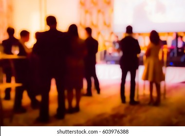 blurred people and waiter on gala dinner party in ballroom