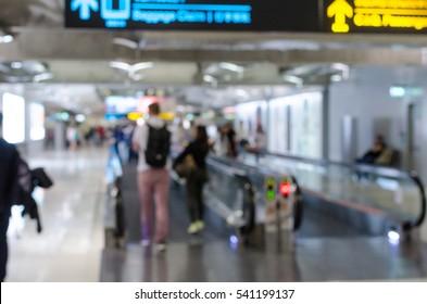 Blurred People Walking on Airport Walkway