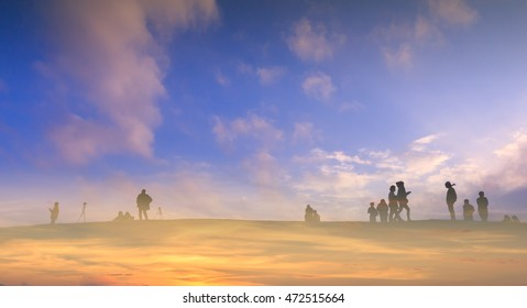 Blurred People Walking on the mountains in sunset