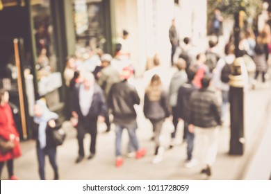 Blurred People Walking on the Street