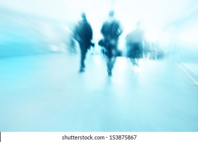 Blurred people walking in subway station.