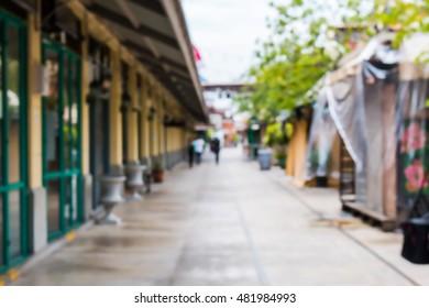 Blurred people walking through a city street blackground