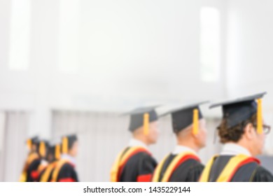 Blurred photo of Back view shot of graduation hats during commencement success graduates of the university,Concept education congratulation master degree.Graduation Ceremony in Christian University
