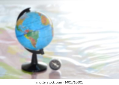 blurred photo background Education concept,Modeled globe with geography books on the table.Study of maps and using geographic tool.Educational innovation.Learning management in 21st century.