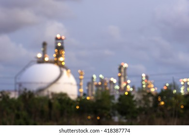 Blurred Photo bokeh for sphere tank oil and gas refinery at twilight