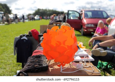 Blurred photo of a car boot sale at which people sell unwanted possessions, typically from the boots of their cars.This flea market is very popular in England.