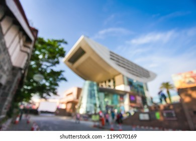 blurred photo of city modern bilding and people urban scene for background use.