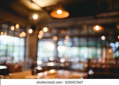 Blurred photo of coffee shop or cafe restaurant with abstract bokeh light image background For create montage product display.