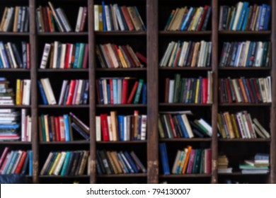 Blurred photo of colorful books in shelves